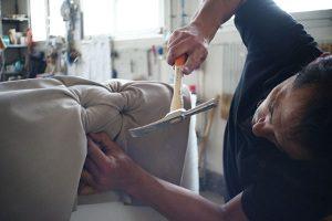 Man building a sofa